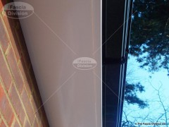 white-fascia-with-black-ogee-guttering