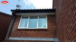 Black square guttering with white tongue and groove soffit