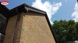 Woodgrain fascias, white soffits with brown square guttering installation