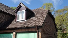Installation of new rosewood UPVC shiplap cladding, fascias, soffits and brown guttering