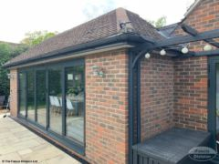 Grey fascia and guttering with white soffit