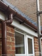 brown round upvc gutters